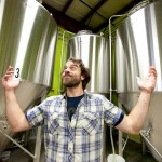 Matt showing the brewing tanks