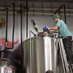 Noah Bissell brewing his beer