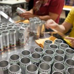 Canning crew, hand labeling every Bissell can