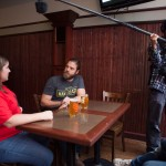 The crew filming Matt's interview with Allison, owner of The Thirsty Pig